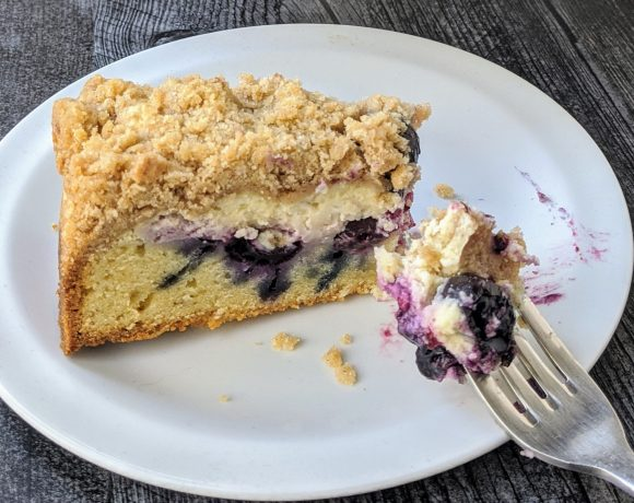 slice of blueberry cheese crumbcake on plate with fork