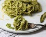 Forkful of twirled spaghetti with asparagus pesto