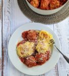 bowl of spaghetti with turkey meatballs and fork
