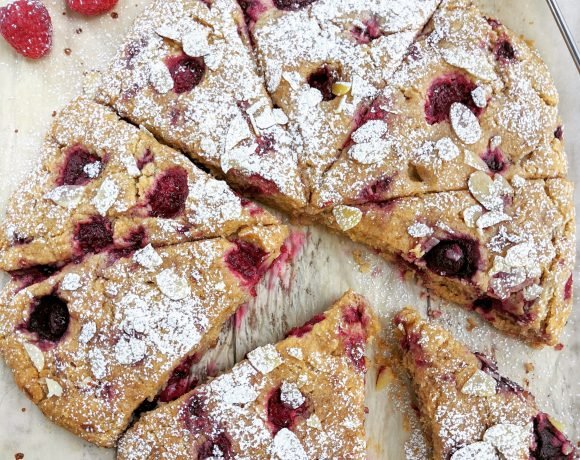Raspberry Almond Scones on a sheet of parchment paper