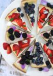 Slices of lemon cheesecake with mixed berries ( blueberry, blackberry and strawberry) topping