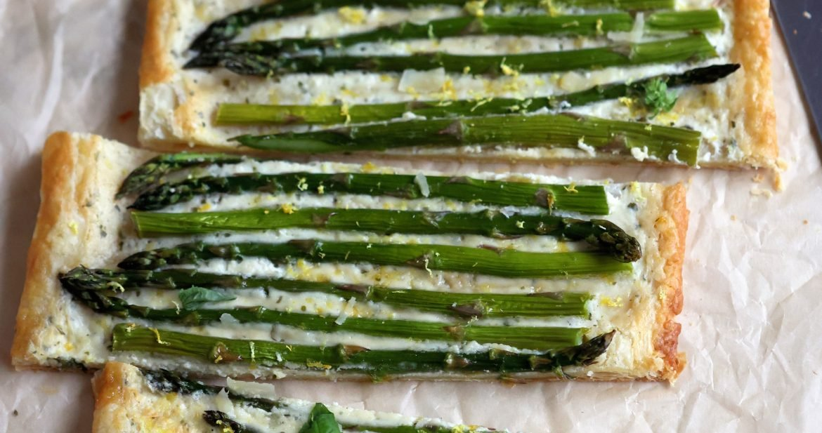 Asparagus Puff Pastry Tart cut into 4 horizontal pieces