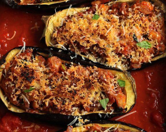 four stuffed eggplant parmesan on board