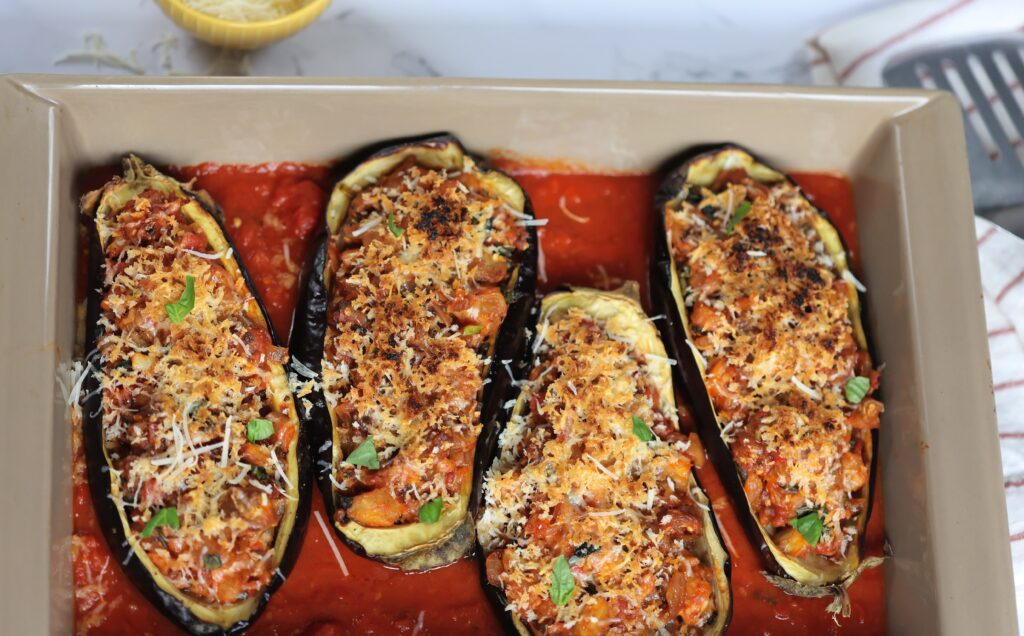 Stuffed Eggplant haves in a baking dish