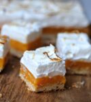 Single Lemon Meringue Bar on board with others in background