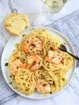 bowl of garlicky shrimp scampi pasta with fork