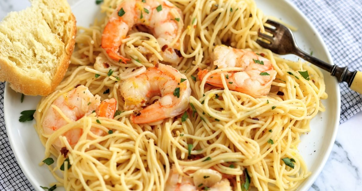 plate of garlicky shrimp scampi with angel hair pasta