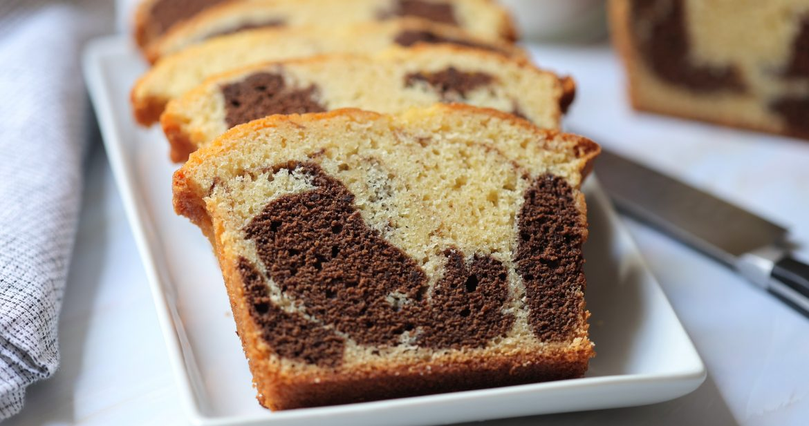 Slices of marbled chocolate and vanilla pound cake on a platter