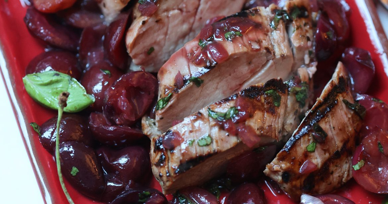 Slices of Pork Tenderloin with Cherry Sauce on a platter
