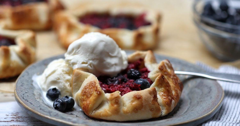mini fruit galette with vanilla ice cream on plate