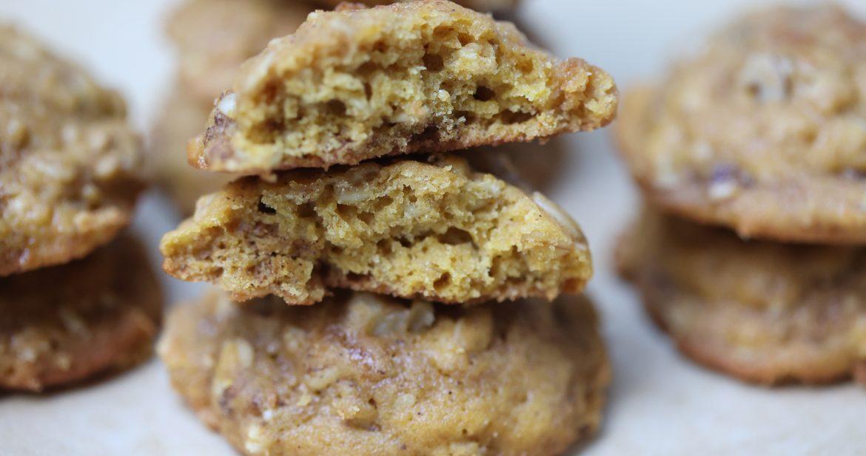 pumpkin nut cookies stacked wth two top one broken in half