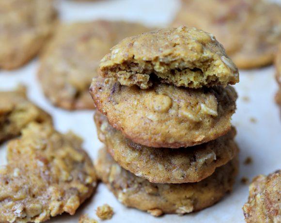 Stack of four pumpkin nut oatmeal cookies with top one broken in half