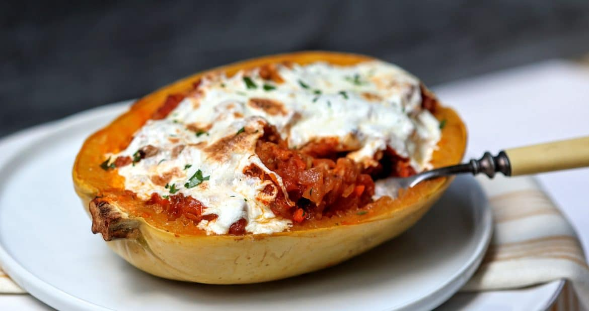 Bolognese-Stuffed Spaghetti Squash on a plate with a forkful removed